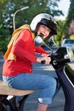 Senior woman riding her scooter Stock Photography