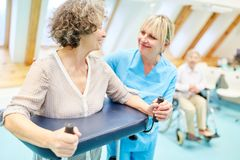 Senior woman with rollator in physiotherapy stock photography