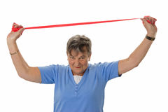 Senior woman with rubber band Royalty Free Stock Photo