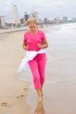 Senior woman running Stock Photo