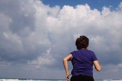 Senior Woman Running On the Beach Royalty Free Stock Photos