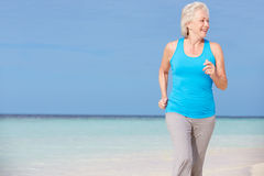 Senior Woman Running On Beautiful Beach Royalty Free Stock Image