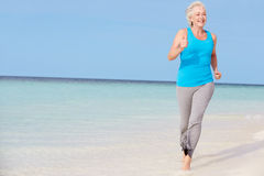 Senior Woman Running On Beautiful Beach Royalty Free Stock Photos
