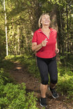 Senior woman running at forest Stock Photos