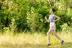 Senior Woman Running in the Forest Royalty Free Stock Photography