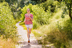 Senior Woman Running in the Forest Stock Photography