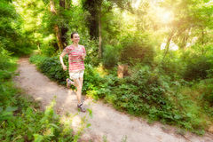 Senior Woman Running in the Forest Royalty Free Stock Photo