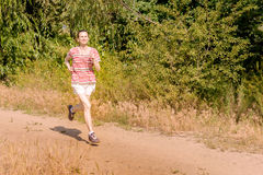 Senior Woman Running in the Forest Royalty Free Stock Images