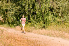 Senior Woman Running in the Forest Royalty Free Stock Photos