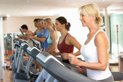 Senior Woman On Running Machine Stock Photo