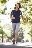 Senior Woman Running Through Park Stock Images