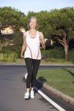 Senior Woman Running On Road Stock Photography