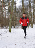 Senior woman running in the snow Stock Images