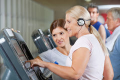 Senior woman running on treadmill Stock Photo
