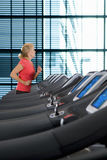 Senior woman running on treadmill in health club Royalty Free Stock Images