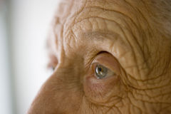 Senior woman's eye. Close-up portrait of an elderly woman Stock Photography