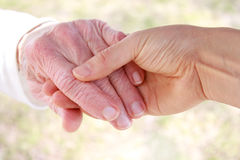 Senior woman's hand and helping hand Royalty Free Stock Photos