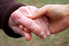 Senior woman's hand and helping hand Royalty Free Stock Image