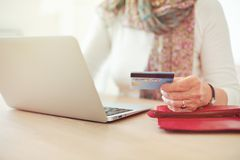 Senior Woman's Hand Holding a Credit Card Royalty Free Stock Image