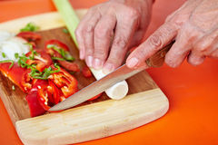 Senior woman's hands cutting vegetables Royalty Free Stock Photography