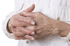 Senior woman's hands isolated on white Stock Photos