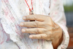Senior woman's hands in pray . Royalty Free Stock Photography