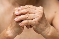 Senior woman`s hands praying, Body language feeling royalty free stock photography