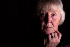 Senior woman sad Stock Photography