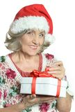 Senior woman in Santa Claus cap Stock Photo