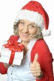 Senior woman in Santa Claus cap Royalty Free Stock Image