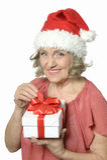 Senior woman in Santa Claus cap Stock Photo