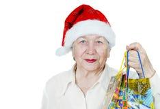 Senior woman in Santa hat Royalty Free Stock Image