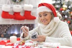 Senior woman in Santa hat Stock Image
