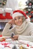 Senior woman in Santa hat Stock Photo