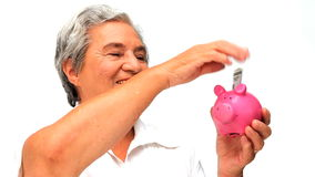 Senior woman saving money stock video