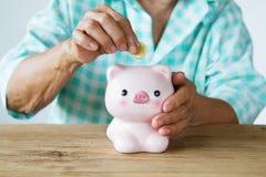 Senior woman saving money stock image