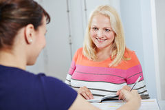 Senior woman scheduling appointment Stock Photography