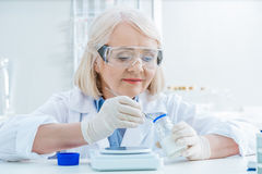 Senior woman scientist working with reagents in lab Royalty Free Stock Images