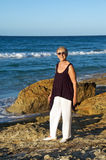 Senior woman by the sea Royalty Free Stock Image