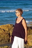 Senior woman by the sea Royalty Free Stock Photo
