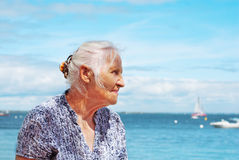 Senior woman seaside Stock Photos