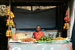 Senior woman selling vegetables in a street market in the city of KODAIKANAL royalty free stock photo