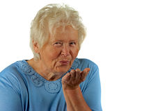 Senior woman is sending a kiss Royalty Free Stock Images