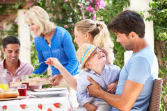 Senior Woman Serving A Family Meal Royalty Free Stock Photos