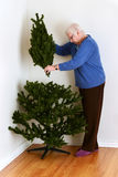 Senior woman setting up christmas tree Stock Image
