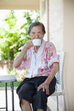 Senior woman seventy years old with good healthy life drinking a Royalty Free Stock Images