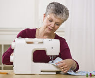 Senior Woman Sewing Stock Images