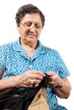 Senior woman sewing Stock Photo
