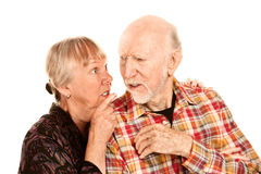 Senior woman sharing information with skeptical ma Royalty Free Stock Photos