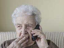 Senior woman shocked / surprised on phone Royalty Free Stock Photo